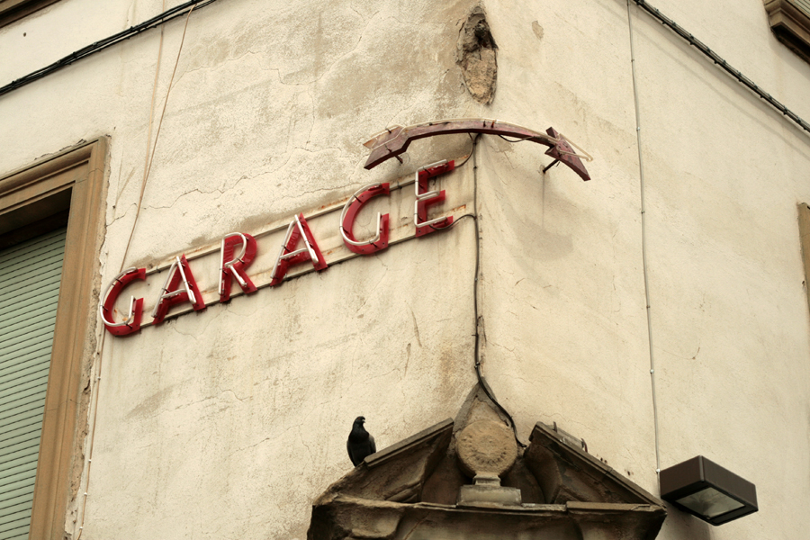 Vernacular Typography Florence Italy neon garage arrow sign